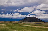 Spring storm developing over 1,182 ft.  Capulin Volcano.  Capulin Volcano National Mounuent, New Mexico.  USA