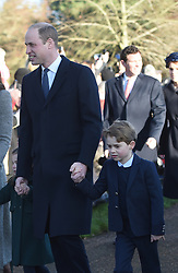 The Duke of Cambridge with his children Prince George and Princess Charlotte arriving to attend the Christmas Day morning church service at St Mary Magdalene Church in Sandringham, Norfolk.