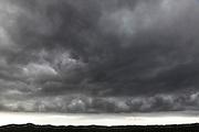 dark stormy clouds above landscape