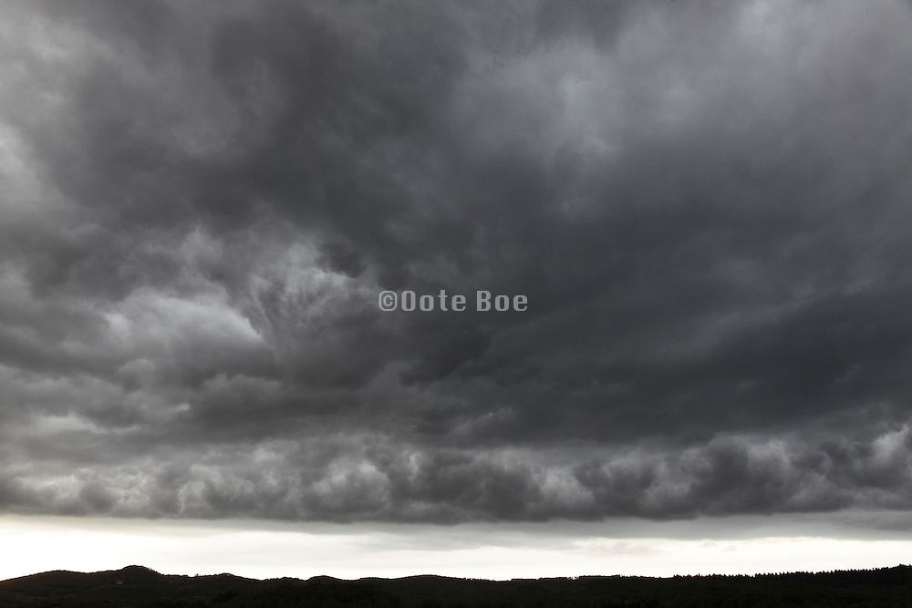 dark stormy clouds above landscape