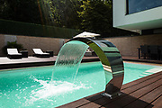Detail of swimming pool with fountain in modern villa. Nobody inside