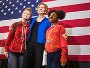 """21 OCTOBER 2019 - DES MOINES, IOWA: US Senator ELIZABETH WARREN (D-MA) poses for """"selfies"""" with students after talking to about 500 students during an assembly at Roosevelt High School in Des Moines. Sen. Warren talked to students about her journey from childhood in Oklohoma to running for the US Presidency. Sen. Warren is campaigning to be the Democratic nominee for the US presidency in Iowa this week. Iowa traditionally hosts the the first selection event of the presidential election cycle. The Iowa Caucuses will be on Feb. 3, 2020.                 PHOTO BY JACK KURTZ"""