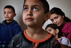 "Yveta Gáborová sits with children Nikolas Ziga, 7, Dominik Ziga, 6, and Jessica Zigová, 4, in Ostrava, Czech Republic on March 4, 2012. Yveta's cousins Denisa and Andrea Bandyová were among 18 Roma children who were represented in the D.H. and Others v. Czech Republic case, the first challenge to systemic racial segregation in education to reach the European Court of Human Rights. However Yveta's children still face discrimination in the schools. When the case was first brought in 2000 Roma children in the Czech Republic were 27 times more likely to be placed in ""special schools,"" intended for the mentally disabled, than non-Roma children. In 2007, the Grand Chamber of the European Court of Human Rights ruled that this pattern of segregation violated nondiscrimination protections in the European Convention on Human Rights. Despite this landmark decision, little change has occurred: the ""special schools"" have been renamed but follow the same substandard curriculum and Roma continue to be assigned to these schools in disproportionate numbers. The process of integration has barely begun."