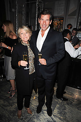GILLY MACWOOD and HUGH MORRISON at a dinner hosted by Ruinart in honour of Amanda Wakely at The Connaught, Carlos Place, London on 20th October 2010.
