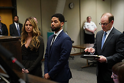 March 26, 2019 - Chicago, Illinois, USA - FILE PHOTO: All charges against actor JUSSIE SMOLLETT -- who had been accused of staging a hate crime and filing a false police report -- have been dropped, his attorneys say. PICTURED: March 12, 2019 - Chicago, IL, USA - Jussie Smollett appears at a hearing for judge assignment with his attorney Tina Glandian, left, at Leighton Criminal Court, Thursday, March 14, 2019. (Credit Image: © E. Jason Wambsgans/Chicago Tribune/TNS via ZUMA Wire)