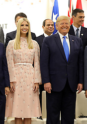 """Ivanka Trump (Advisor to the President of the United States) and Donald J. Trump (US President) - Side event organized by the Japanese Prime Minister, on the theme """"Promoting the place of women at work"""" at the Intex Osaka congress center at the G20 summit in Osaka, Japan, on June 29, 2019. Photo by Dominque Jacovides/Pool/ABACAPRESS.COM"""