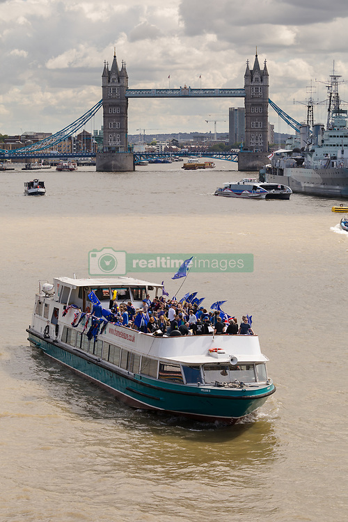 August 19, 2017 - London, London, UK - Anti-Brexit campaign group, The No 10 Vigil, in conjunction with EU Flag Mafia, sail a party boat bedecked with European Union (EU) flags on the River Thames. The pro remain campaigners want the Great Britain to remain in the EU. (Credit Image: © Vickie Flores/London News Pictures via ZUMA Wire)