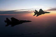 F-15 Eagle banking away into the sunset