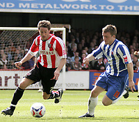 Brentford's Paul Brooker (left) shows Matty Robson a clean pair of heels.
