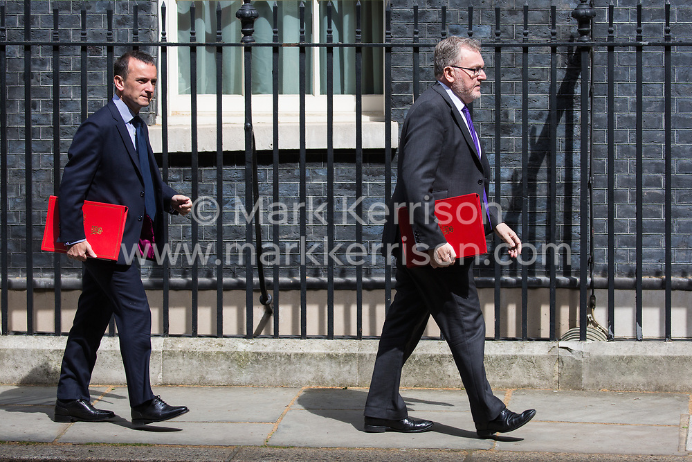 London, UK. 7 May, 2019. David Mundell MP, Secretary of State for Scotland, and Alun Cairns MP, Secretary of State for Wales, leave 10 Downing Street following a Cabinet meeting.