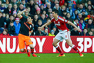 Sheffield Wednesday forward  Fernando Forestieri (45) is fouled by Middlesbrough defender Daniel Ayala (4)  during the The FA Cup match between Middlesbrough and Sheffield Wednesday at the Riverside Stadium, Middlesbrough, England on 8 January 2017. Photo by Simon Davies.