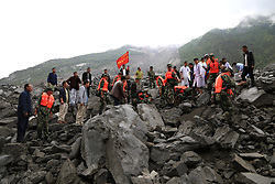 June 24, 2017 - Rescuers work at the accident site after a landslide occurred in Xinmo Village of Maoxian County, Tibetan and Qiang Autonomous Prefecture, southwest China's Sichuan Province. The landslide on Saturday morning smashed some 40 homes, where about 100 people are feared to be buried. (Credit Image: © He Qinghai/Xinhua via ZUMA Wire)