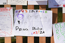 EMBARGOED TO 1100 THURSDAY APRIL 15 Notes left by members of the public outside Buckingham Palace following the death of the Duke of Edinburgh on display in the gardens of Marlborough House, London, during a visit by the Prince of Wales and the Duchess of Cornwall. Picture date: Thursday April 15, 2021.