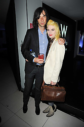 BOBBY GILLESPIE and PAM HOGG at the W Hotels & American Express launch for the James Small collection at Number One Leicester Square, London on 22nd September 2010.