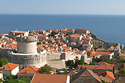 View from above of the old town with city walls and fort brick coloured rooftops roof tops, detail of wall an fortification tower, Minceta Tower Dubrovnik, old city. Dalmatian Coast, Croatia, Europe.