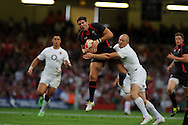 James Hook of Wales(c) is tackled by Mike Tindall of Eng (r)Wales v England, international rugby, World cup warm up match at Millennium Stadium in Cardiff on Sat 13th August 2011. Pic By Andrew Orchard, Andrew Orchard sports photography,