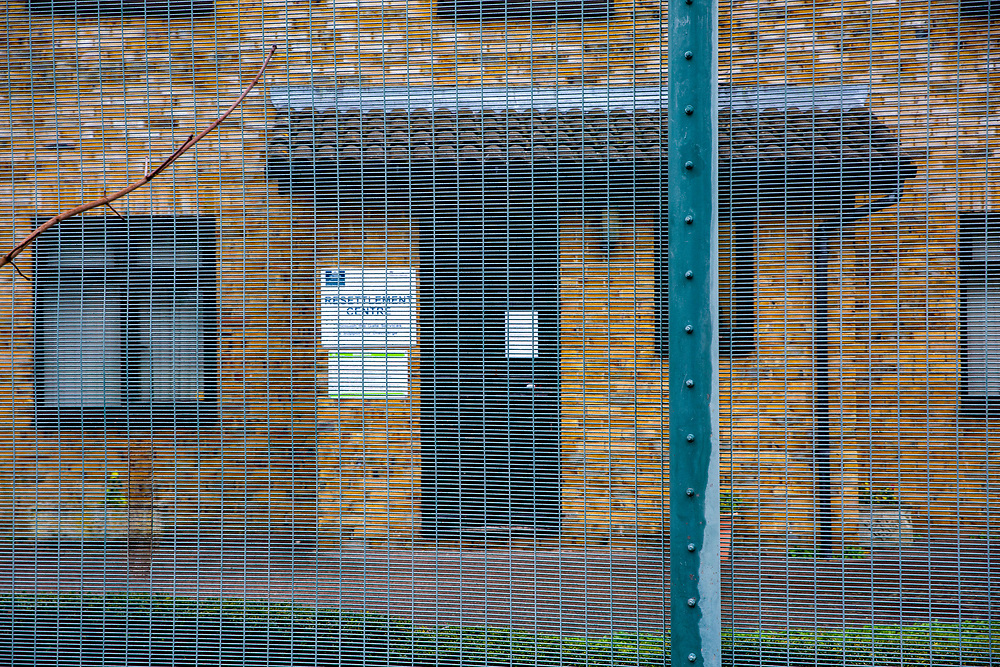 The entrance to the resettlement centre behind a fence inside HMP Downview, Surrey, United Kingdom. The centre provides help for prisoners who are close to their release date with things like housing and work. HMP Downview is a women's closed category prison for adult sentenced women and convicted and remand female young people located on the outskirts of Banstead in Surrey, England. (Picture credit: © Andy Aitchison)