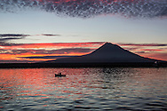 Faial Island, Azores,North Atlantic Ocean, September 2014.<br /> First dawn after 12 days at sea and view of Pico Island from Horta. <br /> © Chiara Marina Grioni