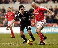 Photo: Leigh Quinnell.<br /> Nottingham Forest v Swansea. Coca Cola League 1. 11/02/2006. Swanseas Rory Fallon keeps an eye on Nottingham Forests Danny Cullip.