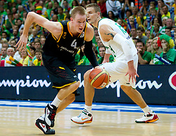 Robin Benzing of Germany vs Robertas Javtokas of Lithuania during basketball game between National basketball teams of Lithuania and Germany at FIBA Europe Eurobasket Lithuania 2011, on September 11, 2011, in Siemens Arena,  Vilnius, Lithuania. Lithuania defeaed Germany 84-75. (Photo by Vid Ponikvar / Sportida)
