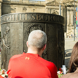 Anfield, Liverpool, UK. 15th April, 2014. Liverpool fans pay tribute to the Hillsborough Memorial in the city centre on the 25th anniversary of the death of 96 fans at Hillsborough.