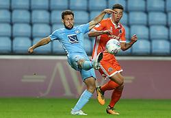 Coventry City's Tony Andreu and Shrewsbury Town's Ben Godfrey