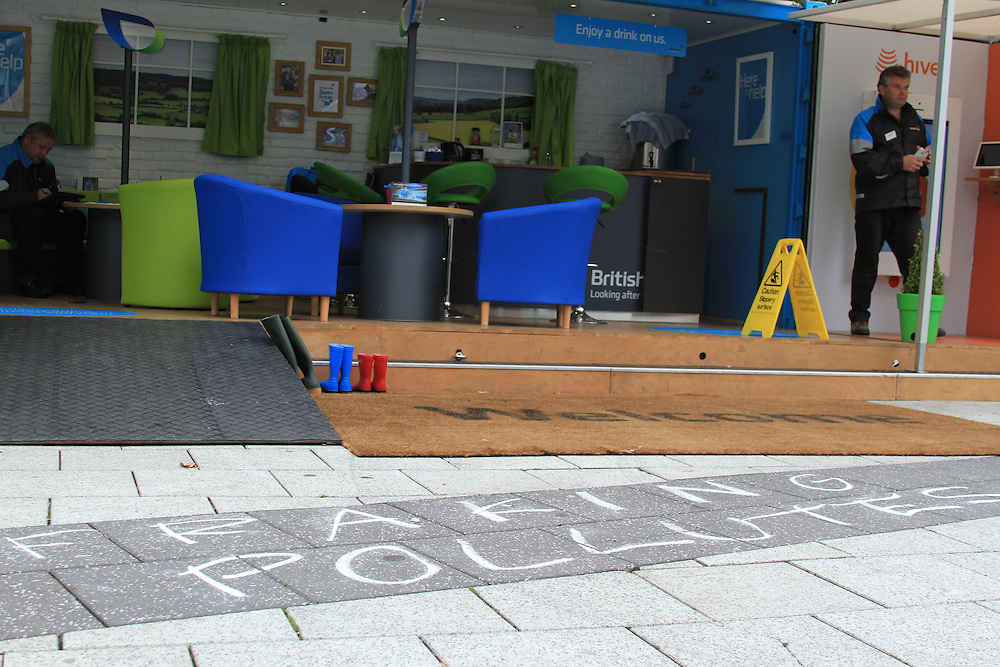 Frack Free Wales protest, Cardiff. Protesters use to chalk to write 'fracking pollutes' to highlight British Gas' involvement in fracking