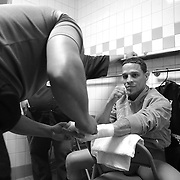 "Jonathan Oquendo gets ready in the dressing room during the ""Boxeo Telemundo"" boxing match at the Kissimmee Civic Center on Friday, March 14, 2014 in Kissimmme, Florida. (Photo/Alex Menendez)"