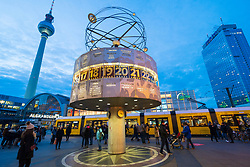 Evening view of World Clock and Television Tower, or Fernsehturm, at Alexanderplatz , Mitte, in Berlin , Germany