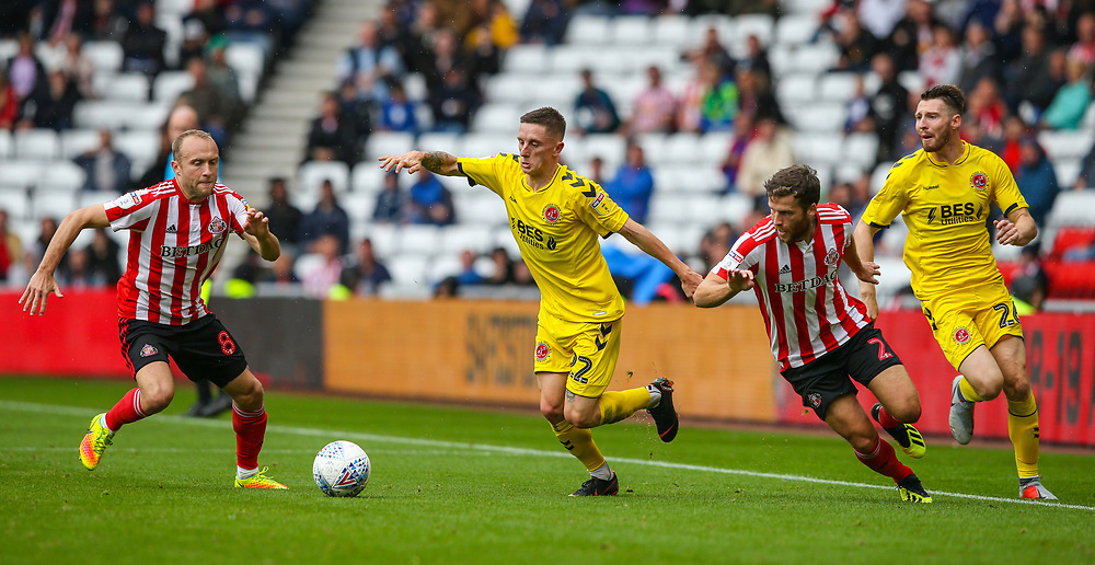Fleetwood Town's Ashley Hunter takes on Sunderland's DylanMcGeouch and Adam Matthews<br /> <br /> Photographer Alex Dodd/CameraSport<br /> <br /> The EFL Sky Bet League One - Sunderland v Fleetwood Town - Saturday September 8th 2018 - Stadium of Light - Sunderland<br /> <br /> World Copyright © 2018 CameraSport. All rights reserved. 43 Linden Ave. Countesthorpe. Leicester. England. LE8 5PG - Tel: +44 (0) 116 277 4147 - admin@camerasport.com - www.camerasport.com