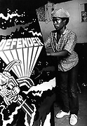 Youth playing 'Defender' game machine. Photo by Richard Saunders 1983
