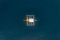 Aerial view of single filipino fishing boat near Lapu-Lapu city, Philippines.