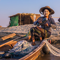 This girl who is untangling the fishing net for the next day moved with her family temporarily to the riverbank of the Chindwin to grow some vegetable, and for some fishing. During dry season, many villagers venture to the riverbanks to settle for some months, growing certain kinds of vegetables and fish for their daily needs. In this connection, it is important to note that Myanmar agriculture is characterized by small-scale, subsistence, family farming. <br /> <br /> It's said that Myanmar has the most favorable agricultural conditions in all of Asia. This image shows the rural area life in the near of Monywa Tonwship on the Chindwin river.