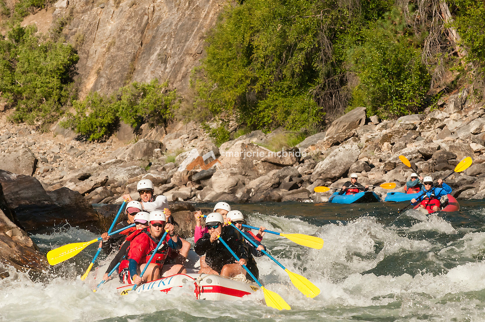 Early morning light boating in The Impassible Canyon on the Middle Fork of the Salmon River during six day rafting vacation, Idaho.
