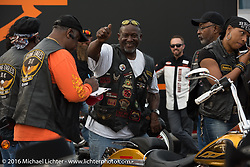 """Archie of the Flying Eagles MC having some fun at the Harley-Davidson display at """"Biking on the Boulevard"""" on Dr. Mary McLeod Bethune Blvd during Daytona Bike Week 75th Anniversary event. FL, USA. Friday March 11, 2016.  Photography ©2016 Michael Lichter."""