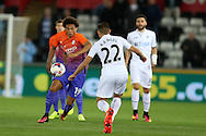 Leroy Sane of Manchester city (l) looks to go past Angel Rangel of Swansea city. EFL Cup. 3rd round match, Swansea city v Manchester city at the Liberty Stadium in Swansea, South Wales on Wednesday 21st September 2016.<br /> pic by  Andrew Orchard, Andrew Orchard sports photography.