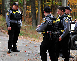 Police continue to search the heavily wooded terrain for fugitive Eric Matthew Frein on Oct. 3, 2014, near Canadensis, Pa. (Chris Post | lehighvalleylive.com)