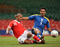 Photo: Rich Eaton.<br /> <br /> Wales v Cyprus. UEFA European Championships 2008 Qualifying. 11/10/2006. Robert Earnshaw left of Wales and Loukas Louka clash in the penalty box