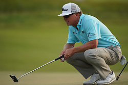 June 16, 2018 - Southampton, NY, USA - Charley Hoffman lines up a put on the 18th green during the third round of the 2018 U.S. Open at Shinnecock Hills Country Club in Southampton, N.Y., on Saturday, June 16, 2018. (Credit Image: © Brian Ciancio/TNS via ZUMA Wire)