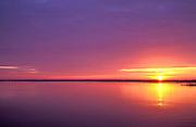 Sunrise over a calm Winyah Bay