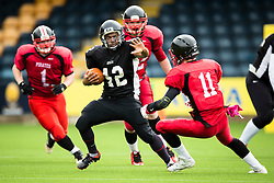 Kent Exiles running back powers through the East Kilbride Pirates defence - Mandatory by-line: Jason Brown/JMP - 27/08/2016 - AMERICAN FOOTBALL - Sixways Stadium - Worcester, England - Kent Exiles v East Kilbride Pirates - BAFA Britbowl Finals Day