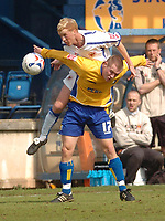 Photo: Leigh Quinnell.<br /> Mansfield Town v Carlisle United. Coca Cola League 2. 22/04/2006. Carlises Chris Lumsdon rises above Mansfields Callum Lloyd.