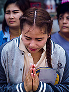 """02 JUNE 2017 - SAMUT SAKHON, THAILAND: People pray as the City Pillar Shrine is taken through the streets of Samut Sakhon during the procession honoring the shrine. The Chaopho Lak Mueang Procession (City Pillar Shrine Procession) is a religious festival that takes place in June in front of city hall in Samut Sakhon. The """"Chaopho Lak Mueang"""" is  placed on a fishing boat and taken across the Tha Chin River from Talat Maha Chai to Tha Chalom in the area of Wat Suwannaram and then paraded through the community before returning to the temple in Samut Sakhon. Samut Sakhon is always known by its historic name of Mahachai.      PHOTO BY JACK KURTZ"""