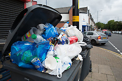 © Licensed to London News Pictures. 12/08/2016. Birmingham, UK. The strike by Birmingham bin men continues as they announce strike action up to Christmas. Pictured, rubbish building up in Washwood Heath Road, Ward End. Photo credit: Dave Warren/LNP