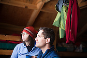 Emily Miller and Judd MacRae enjoy the view from the backcountry North Pole Hut, San Juan Mountains, Colorado.