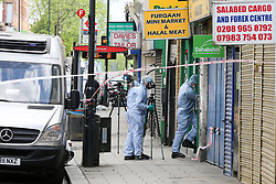 © Licensed to London News Pictures. 24/04/2019. London, UK. Forensic officers enters Paddy Power on Harlesden High Street, Brent in West London where a 21 year old man was stabbed on Tuesday 23 April 2019 at 9.07pm. According to the Met Police, the suspects arrived in two cars before blocking traffic in order to carry out the attack. The victim fled into a bookmakers (Paddy Power) to seek help before the arrival of emergency services. The victim was pronounced dead at a hospital at 2.47am on Wednesday 24 April 2019. Photo credit: Dinendra Haria/LNP