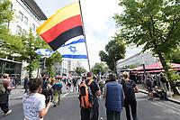 """29 AUG 2020, BERLIN/GERMANY:<br /> Demonstrant mit umgekehrter deutschen und Israel-Flagge, Demonstration gegen die Einschraenkungen in der Corona-Pandemie durch die Initiative """"Querdenken 711"""" aus Stuttgart unter dem Motto """"invites Europa - Fest für Freiheit und Frieden"""", Unter den Linden<br /> IMAGE: 20200829-01-027<br /> KEYWORDS: Demo, Protest, Demosntranten, Protester, COVID-19, Corona-Demo"""