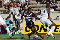 Fotball<br /> Frankrike 2004/05<br /> Bordeaux v Rennes<br /> 18. september 2004<br /> Foto: Digitalsport<br /> NORWAY ONLY<br /> ANTONIO MAVUBA (BOR) / JEAN JOEL PERRIER DOUMBE / ABDESLAM OUADDOU (REN