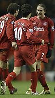 Photo: Aidan Ellis.<br /> Liverpool v Arsenal. The Barclays Premiership. 14/02/2006.<br /> Liverpool's Harry Kewell congratulates goal scorer Luis Garcia