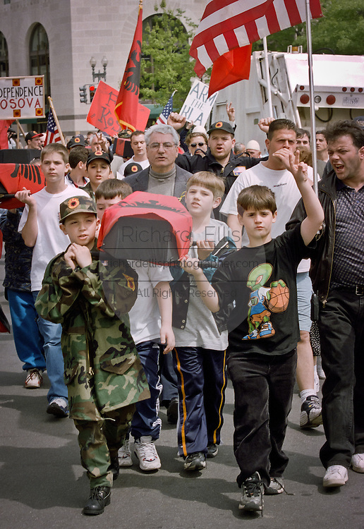 Protestors demanding an independent Kosovo march past the White House April 27, 1999.